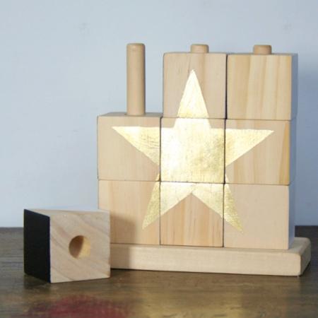 Schlagmetall auf Holz